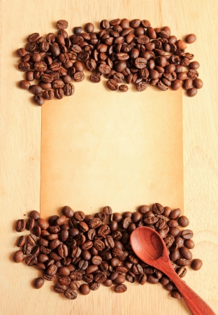 Coffee beans and spoon with old paper on the wooden background Stock Photo - 14315802