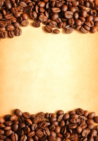 Coffee beans with old paper background for notes  photo