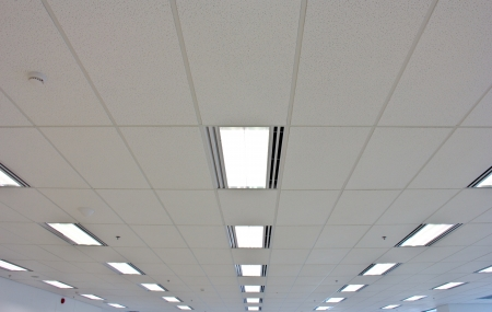 high ceiling: Lights from ceiling of business building