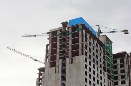 office building under construction in cloudy day photo