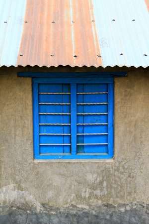 Old color wooden window on cement wall photo
