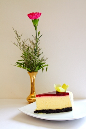 sweet cake with strawberry on a plate with flower photo