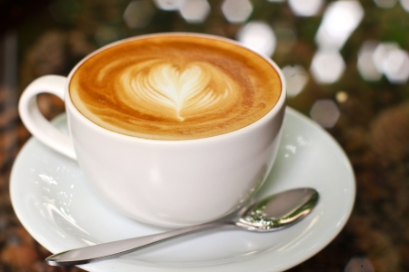 Cappuccino or latte coffee with heart shape photo