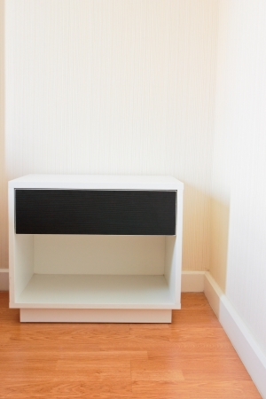 Modern bedside table with drawer on wooden floor Stock Photo - 15314984