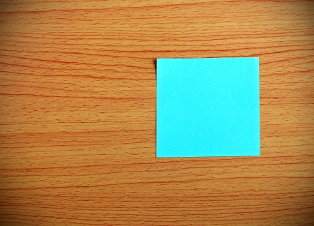 Blue paper on wooden table photo