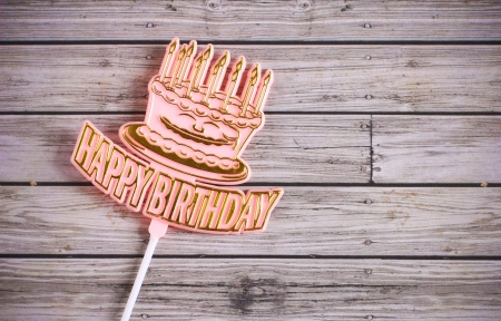 happy birthday  on wooden background photo