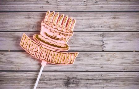 happy birthday  on wooden background Stock Photo
