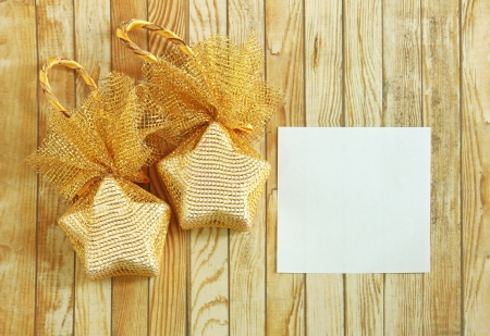 Christmas decoration with blank notebook over wooden background  photo