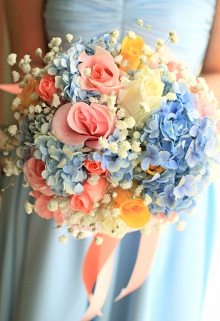 life event: Bride or bridemaid with bouquet, closeup