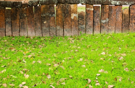 Stone block wall with green grass photo
