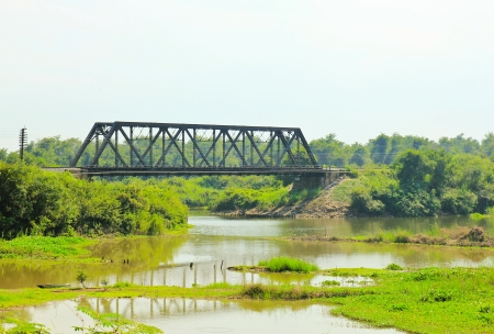 geen: Ancient bridge over the river in Thailand