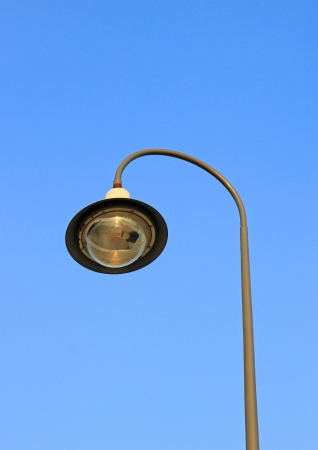 street light against a blue sky