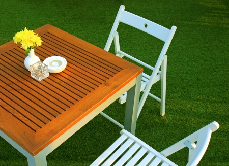 restaurant exterior: Table and chair setting with flower in outdoor restaurant