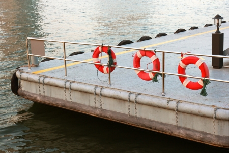 Life preserver and pontoon on the river photo
