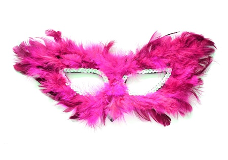 Fancy pink mask with feathers on white background photo