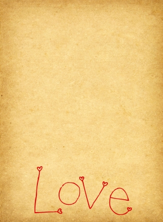 Handwriting love word on old grunge paper  photo