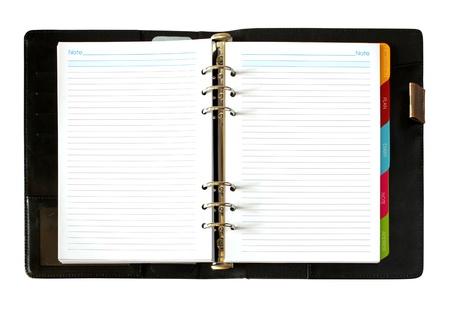 革は、白い背景で隔離ノートブックを開く
