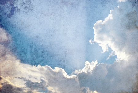 Grunge image of sun and cloud in the sky photo