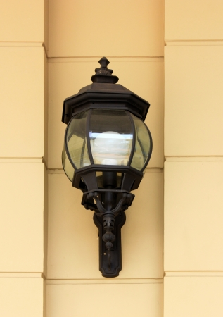 Vintage street lamp on yellow wall  photo