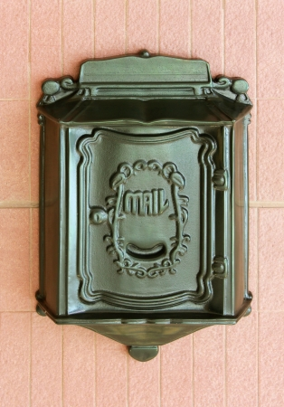 await: Antique metal mail box on the wall  Stock Photo