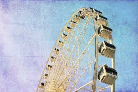 Ferris wheel with blue sky, photo in old image style photo