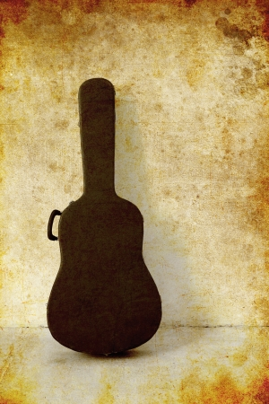 guitar case: The Old Guitar case on white wall, photo in old image style Stock Photo