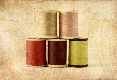 needlecraft product: Different colors of thread spools, photo in old image style Stock Photo