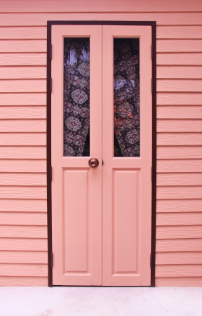 Pink front door to the house Stock Photo - 19605811
