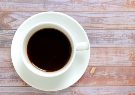 coffee table: Black coffee in white cup Stock Photo
