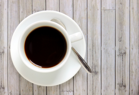 Black coffee in white cup with spoon Stock Photo - 20010330