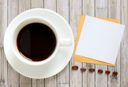 Blank paper with hot coffee cup and coffee beans Stock Photo - 20010321