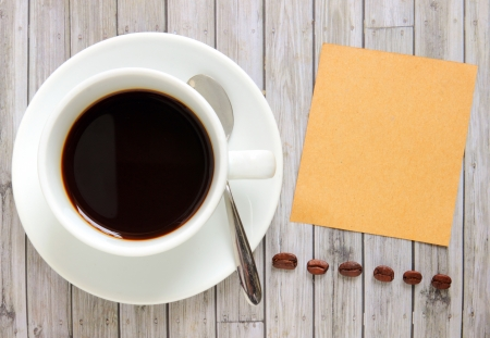 Blank paper with hot coffee cup and coffee beans Stock Photo - 20010328
