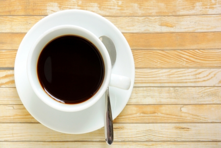 Black coffee in white cup on a wooden table  Stock Photo - 20010326