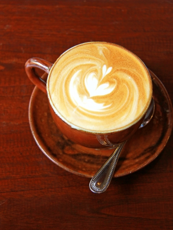 latte art: Cappuccino or latte coffee with heart shape