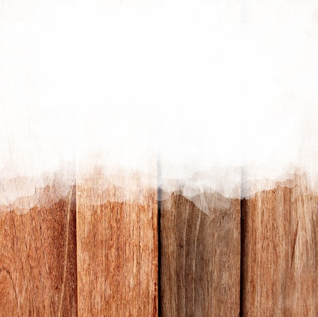 White stroke of the paint brush on wooden background  photo
