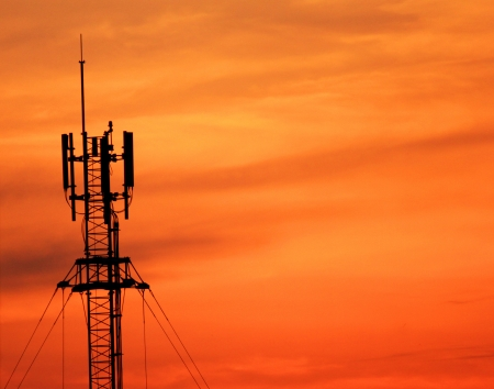Antenna tower of communication with sunset photo