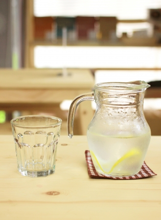 lemon water: Jar of lemonade with empty glass for summer