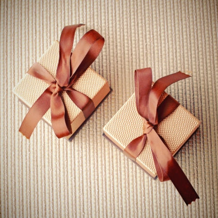 Luxury gift boxes with ribbon, retro filter effect  Stock Photo