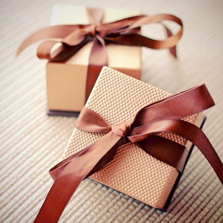 Luxury gift boxes with ribbon, retro filter effect  Stockfoto