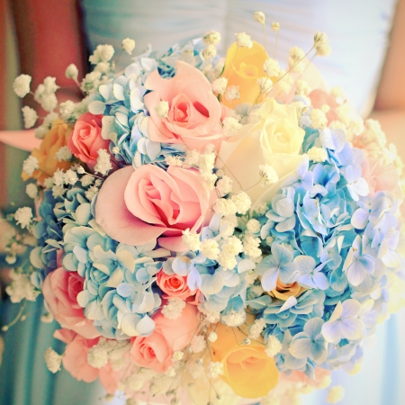 arm bouquet: Bride or bridemaid with bouquet, closeup with retro filter effect