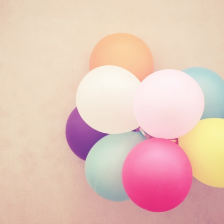 opening party: Colorful balloons on wall with retro filter effect