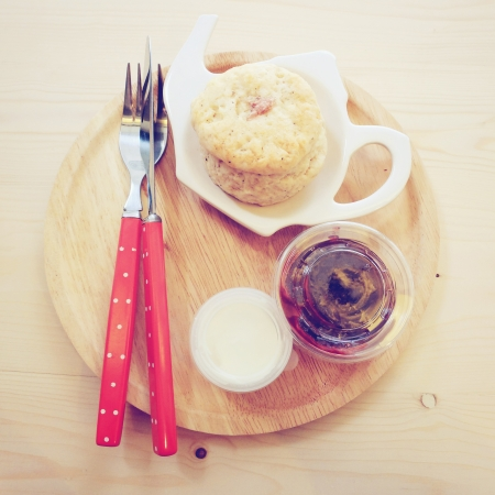 Homemade scone with strawberry jam photo