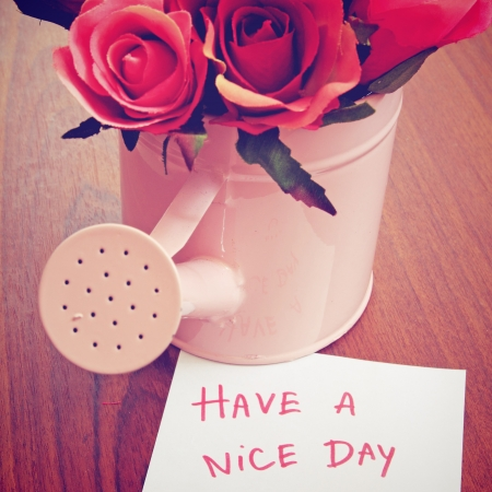 have: Message  have a nice day  with roses in watering can