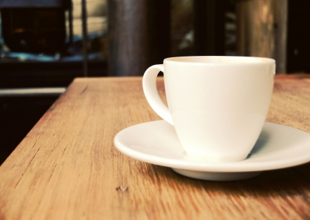 furniture shop: Closeup of cup of coffee on table at coffee shop