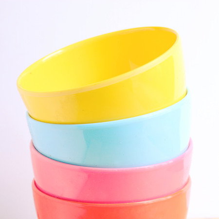 Stack of colorful plastic bowl with retro filter effect photo