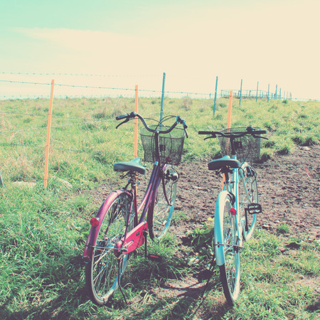 bike parking: Two bicycles with retro filter effect Stock Photo