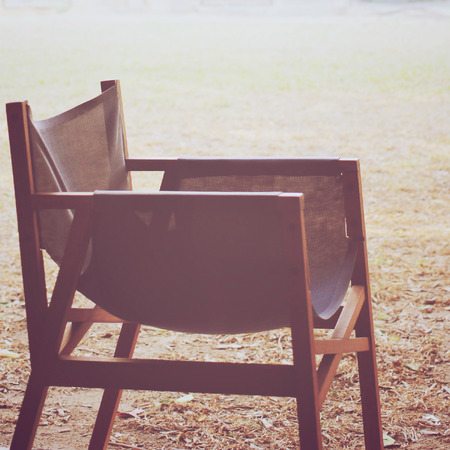 side effect: Modern wood chair in the garden with retro filter effect