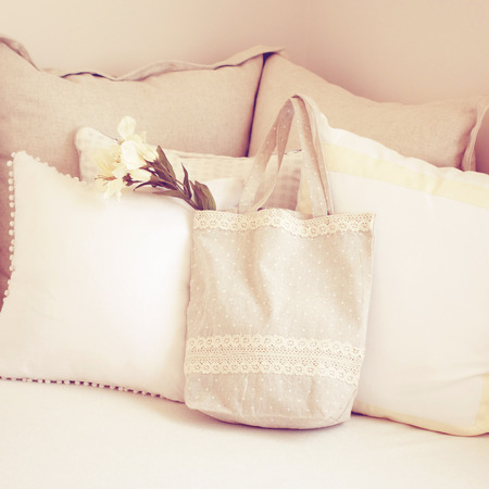 tote: Cute tote bag and pillows on bed with retro filter effect