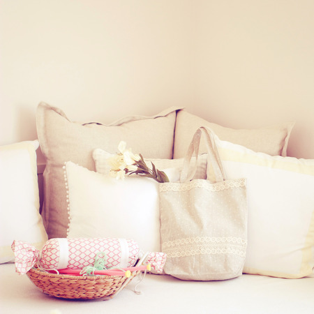 basket embroidery: Knitting needles in basket and cute tote bag on the bed with retro filter  Stock Photo