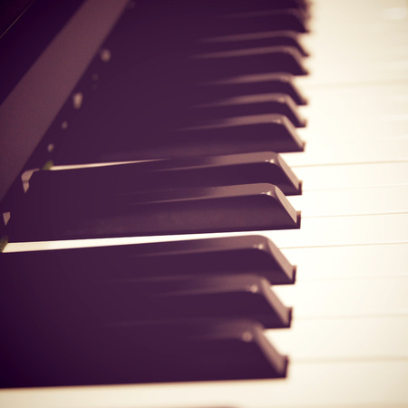hymnal: Close up of piano keys with retro filter effect